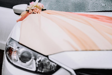 Wedding car decorations. The decor of the fabric. Wedding accessories