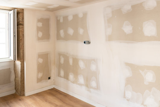 Renovation of an old house with plaster board. Unfinished Drywall