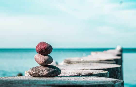 zen stones on the beach with sea view