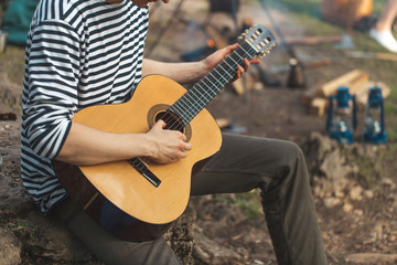 close up cropped photo. hiker enjoying playing the musical instrument,free time, spare time
