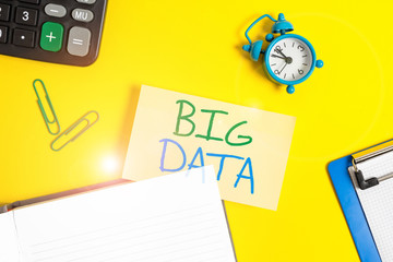 Text sign showing Big Data. Business photo showcasing sets that so complex that traditional software cant deal with them Empty orange paper with copy space on the yellow table