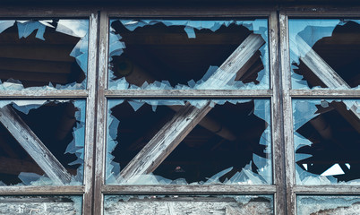 close up of a broken window of an old ruin