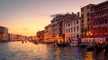 Fototapete - Venice in summer dusk, Italy. Panorama of famous Grand Canal, famous street of Venice. Beautiful cityscape of Venice with old houses at sunset. Landscape of Venice city in evening light.