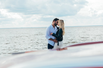 Fotomurales - attractive woman and handsome man hugging and kissing outside