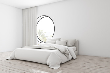 White bedroom corner with round window