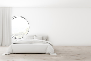 White bedroom interior with round window