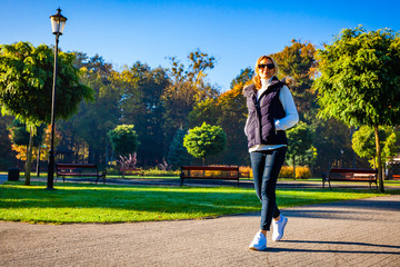Foto op Canvas Ontspanning Middle-aged woman walking in city park