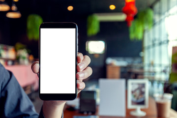 hand showing modern phone design with blank screen phone in cafe.