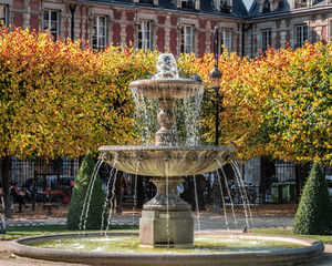 One of the four Cortot fountains in the beautiful Place des Vosges in Paris, France.