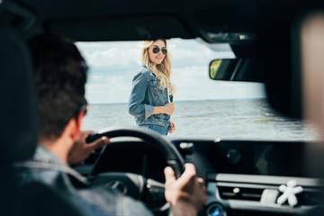 Fotomurales - selective focus of attractive woman in denim jacket looking at man