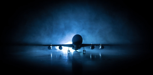 Poster Avion à Moteur Artwork decoration. White passenger plane ready to taking off from airport runway. Silhouette of Aircraft during night time.