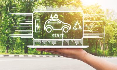 Digital tablet with hologram of EV car charging system