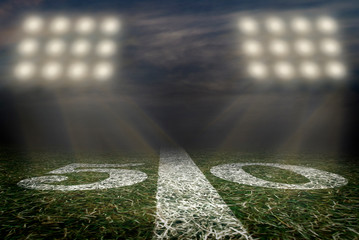 American Football 50 yard line football field friday night lights