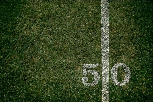 American Football 50 yard line football field and game