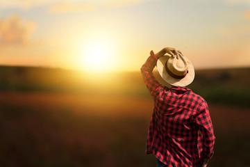 Farmer at sunset outdoor Fototapete