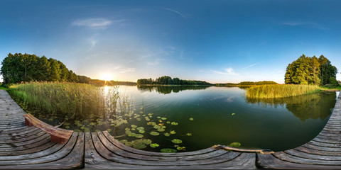 full seamless spherical hdri panorama 360 degrees angle view on wooden pier near lake in evening in equirectangular projection with zenith, ready VR AR virtual reality content
