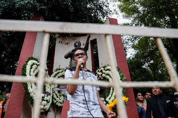 A man sings one of Jose Jose's songs to pay tribute to the Mexican singer and songwriter, who died in Miami after complications following treatment for pancreatic cancer, at his statue in Mexico City