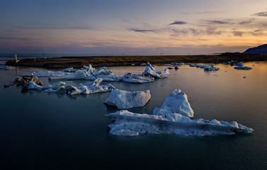 Blue icebergs floating in the jokulsarlon lagoon in Iceland in the september 2019