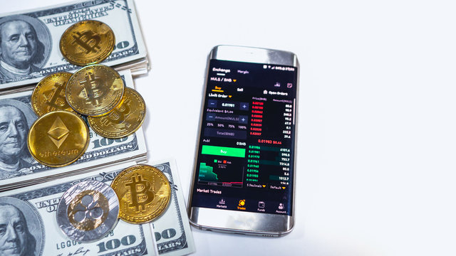 Saraburi, Thailand/ September 2019 :Mobile on screen logo binance  and bitcoin coin, ETH, XRP  put on US dollar. Concept news about trading web binance of Chinese digital money.