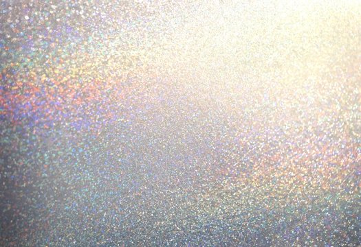 Silver shimmer decorative texture. Brilliant dust abstract background. Bright glitter surface. Winter celebration.