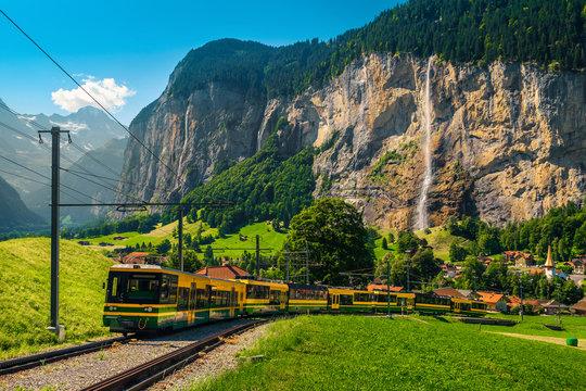 Electric tourist train and Lauterbrunnen village in background, Switzerland