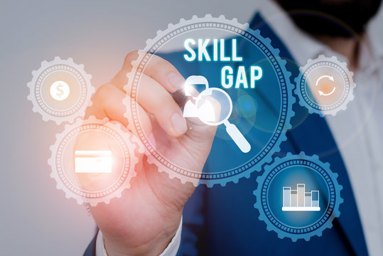 Text sign showing Skill Gap. Business photo showcasing Refering to a demonstrating s is weakness or limitation of knowlege Male human wear formal work suit presenting presentation using smart device