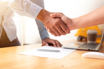 Image of asian business handshaking after good deal at office. meeting concept.