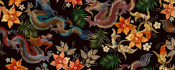 Embroidery asian dragon and beautiful yellow daffodils flowers seamless pattern. Oriental style. Japan and China art