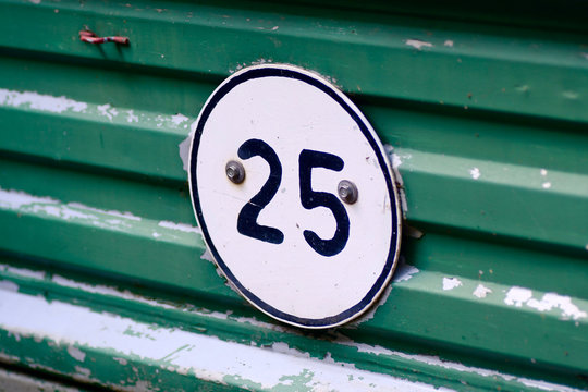 aslant view geometrec shapes round, 25  mph speed limit sign on green sheet groove background of tractor