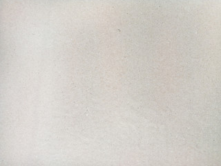 Beige, brown background is backed from cardboard, recycled paper, top view