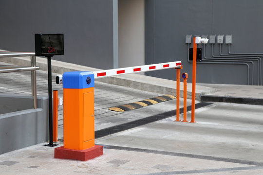 Automatic barrier gate with RFID Card dispenser system for car parking.