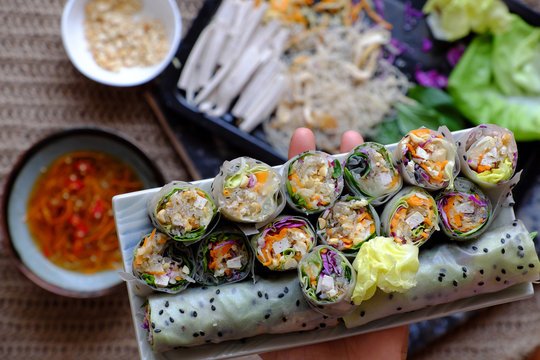 sliced vegan rice paper rolls on spring roll ingredient background