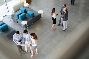 Fotobehang - Group of coworkers working together on business project in modern office
