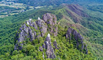 Aerial shot of the Chalermprakiat Prajomklao Rachanusorn chedis on the mountain top, Lampang province, Thailand