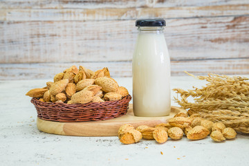 Delicious almonds nut with shell on wood background