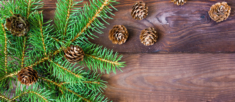 Christmas flat lay.Christmas tree branches and holiday decorations on wooden background with copy space.