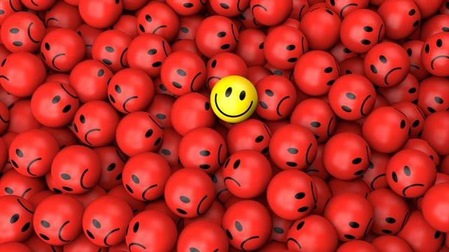One yellow happy smile between many red spherical sad others as concept for unique, optimistic, positive, difference 3D rendering