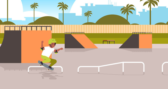 male skater performing tricks in public skate board park with ramp for skateboarding teenager having fun riding skateboard landscape background flat full length horizontal