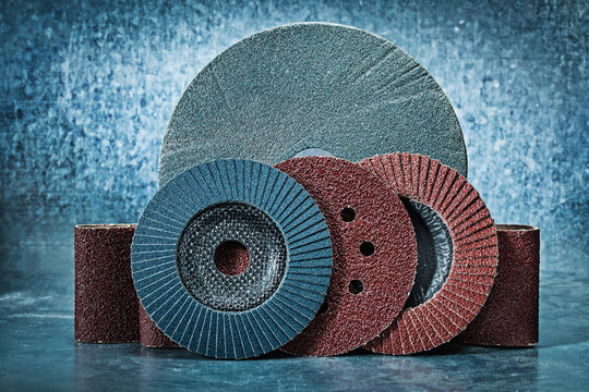 abrasive discs and tapes on metalic background