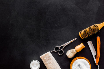 Men's hairdressing tools on black background top view space for text