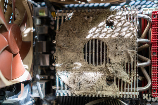Closeup of a CPU heat sink clogged with dust preventing proper airflow. Outdated and abandoned technology. Server vulnerability concept.