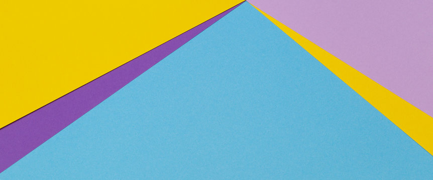 Abstract geometric paper banner background with trendy light blue, yellow, pink, purple color paper texture background