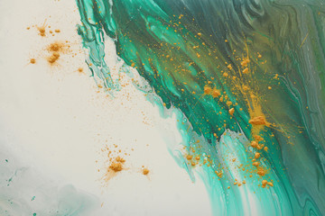 art photography of abstract marbleized effect background. emerald green, white and gold creative...