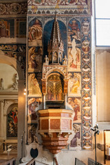 Beautiful medieval frescoes decorating pulpit in italian catholic church