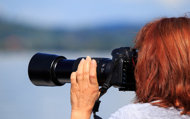 Photographer and traveler with big lens and camera