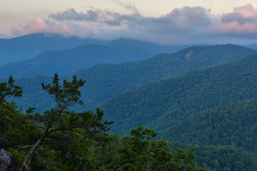 Mountains and low clouds near sunrise in Nelson County, Virginia.  Photographed along the Blue RIdge Parkway..