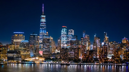 Wall Mural - Aerial view of Lower Manhattan skyline by in night in New York City