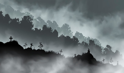 The old abandoned graveyard on the hill in front of the mountains covered with forest.