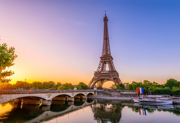 Fotobehang Eiffeltoren View of Eiffel Tower and river Seine at sunrise in Paris, France. Eiffel Tower is one of the most iconic landmarks of Paris