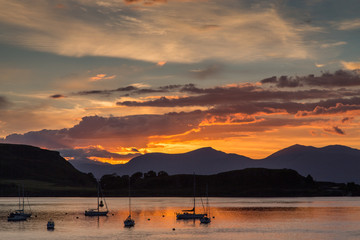 Orange Sunset Over the Harbor of Oban, Scotland